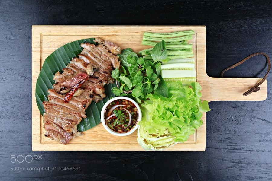 Delicious beef steak on wooden table close-up by Mercedess