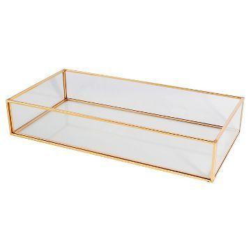 glass and metal vanity tray threshold