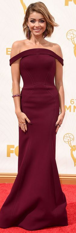 Who made Sarah Hyland's red off the shoulder gown and jewelry?