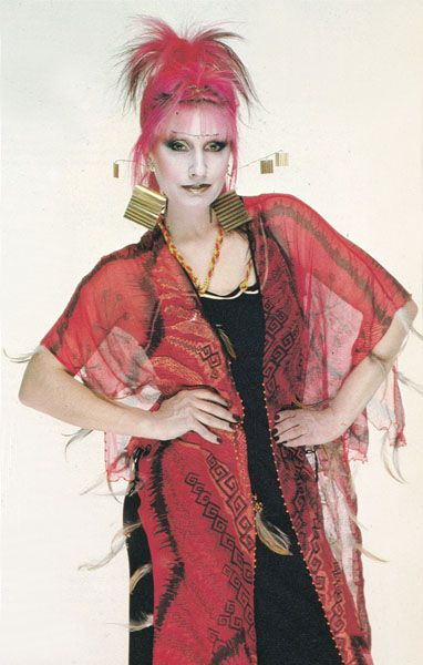 Zandra Rhodes modeling one of her creations, c.1980. Photographed ...