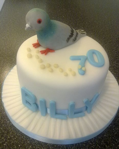 White round 70th cake with pigeon on top.JPG