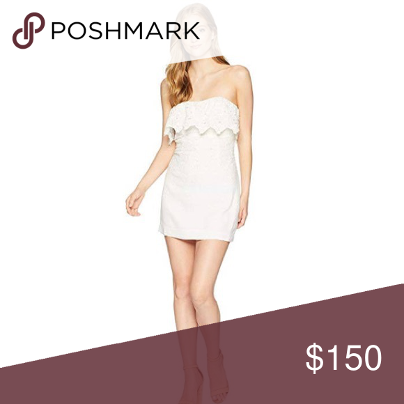 FREE PEOPLE COTTON STRAPLESS DRESS FREE PEOPLE LACE COTTON STRAPLESS MINI DRESS   NEW WITH TAGS  SIZE- Tagged size 4 (approx. size S)  DETAILS: - Square neck with popover - Strapless - Hidden back zip closure  - Lace construction  - Lined  - Approx. 23.5
