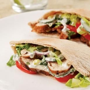 Indian-Spiced Chicken Pitas-- Make a perfect summer supper: grill spice-rubbed chicken breasts and tuck them into whole-wheat pitas along with fresh vegetables and a tangy yogurt sauce. @EatingWell