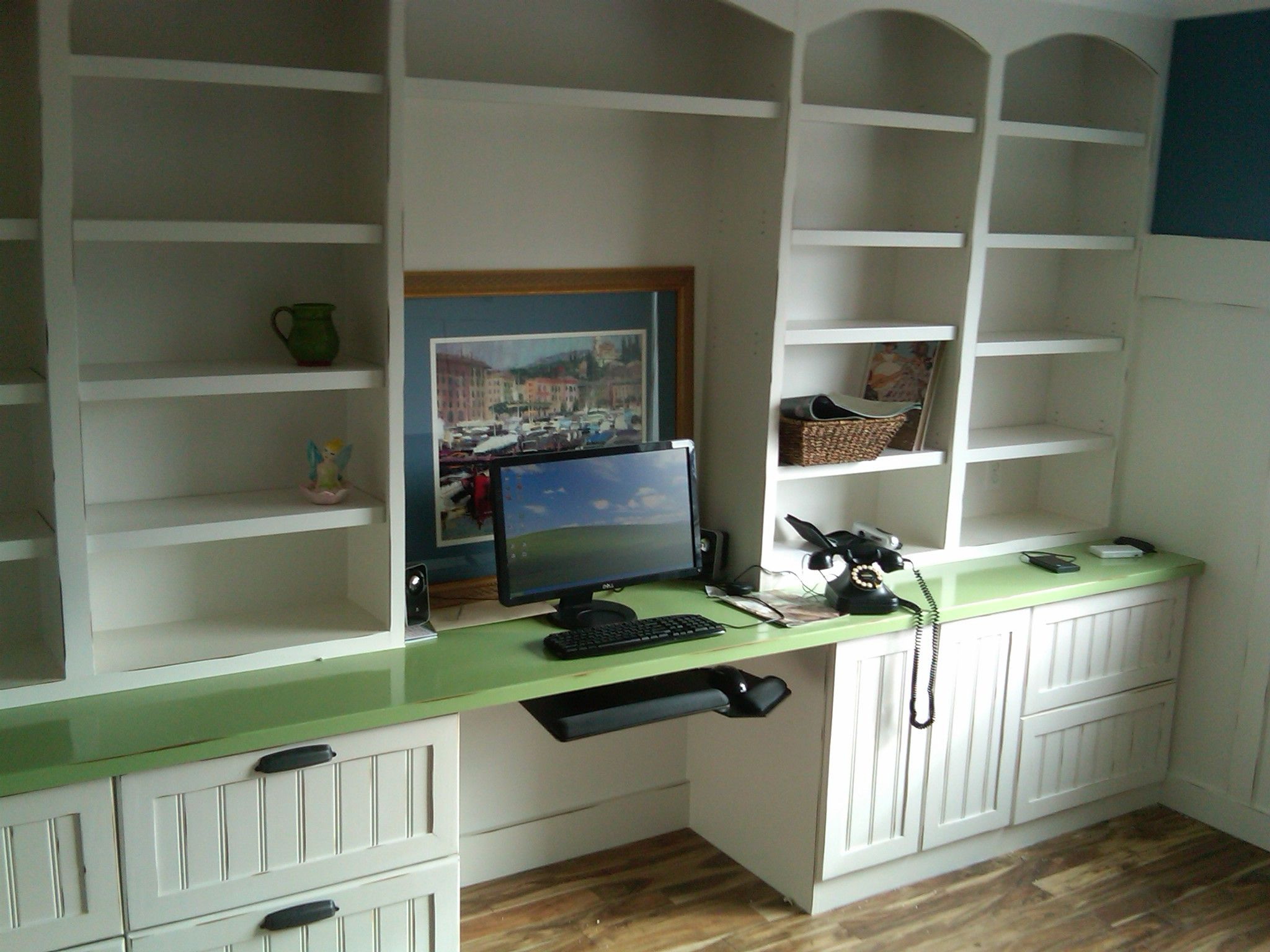 Built In Bookshelves With Built In Desk That Protrudes Out A Bit
