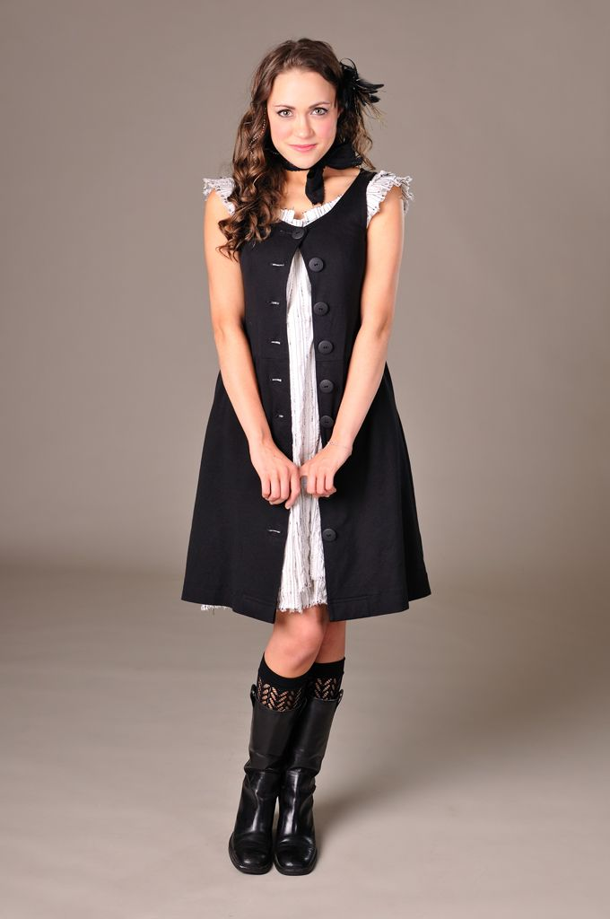 """Miss Elaini's """"1 dress, 100 days"""" project, Day 58.  I love the frilly edges of the under-dress and that she chose boots."""