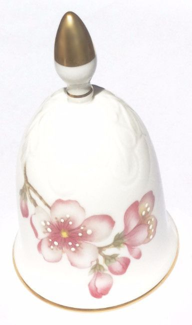 Not content with simply decorating this bell with beautiful pink cherry blossoms, Sutherland China adds, by hand, touches of enamel to give a raised effect to the flowers. The crowning glory of this s