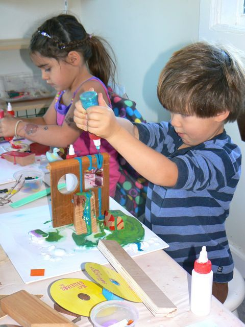 Colored glue and recycled materials sculpture