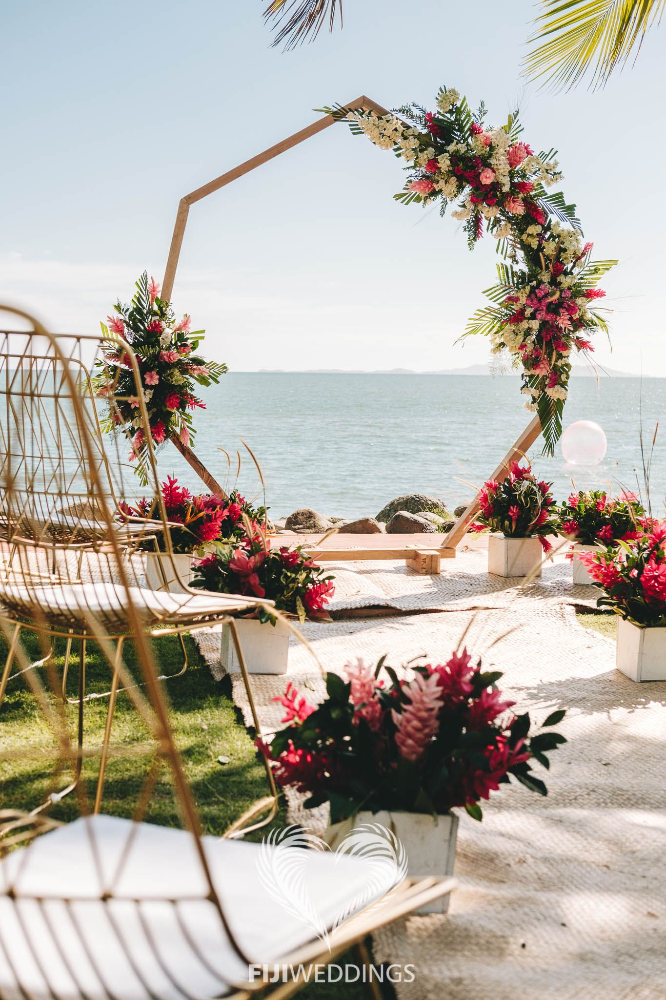 Our Geometric Ceremony Setup With Fresh Flowers And Gold