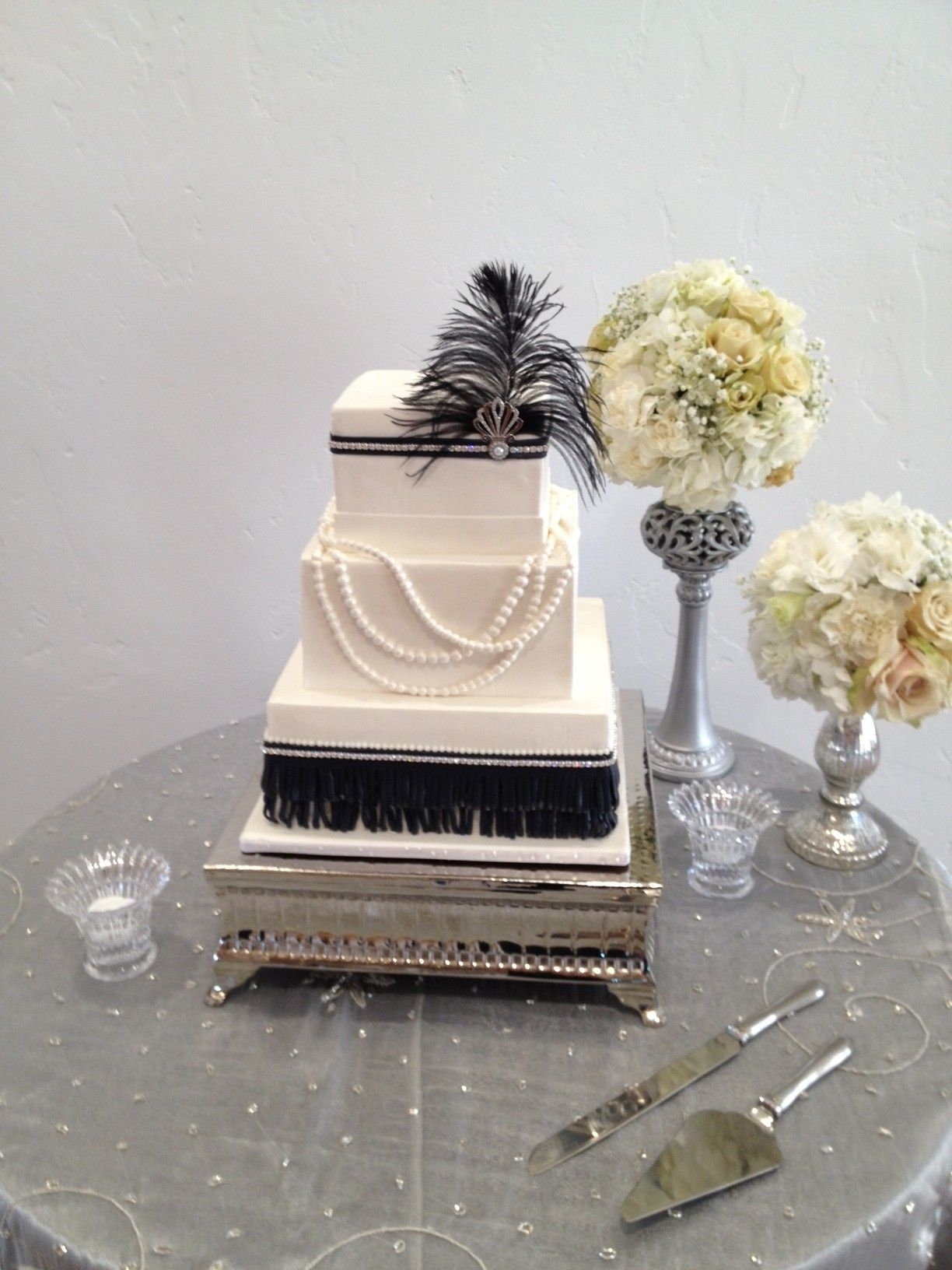 1920s wedding decoration ideas  Feathers pearls broaches fringeuld this cake be more perfect