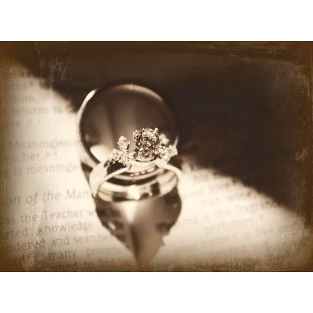 Me and my husband's rings on a page of the bible, taken by my mother-in-law.  So cool!