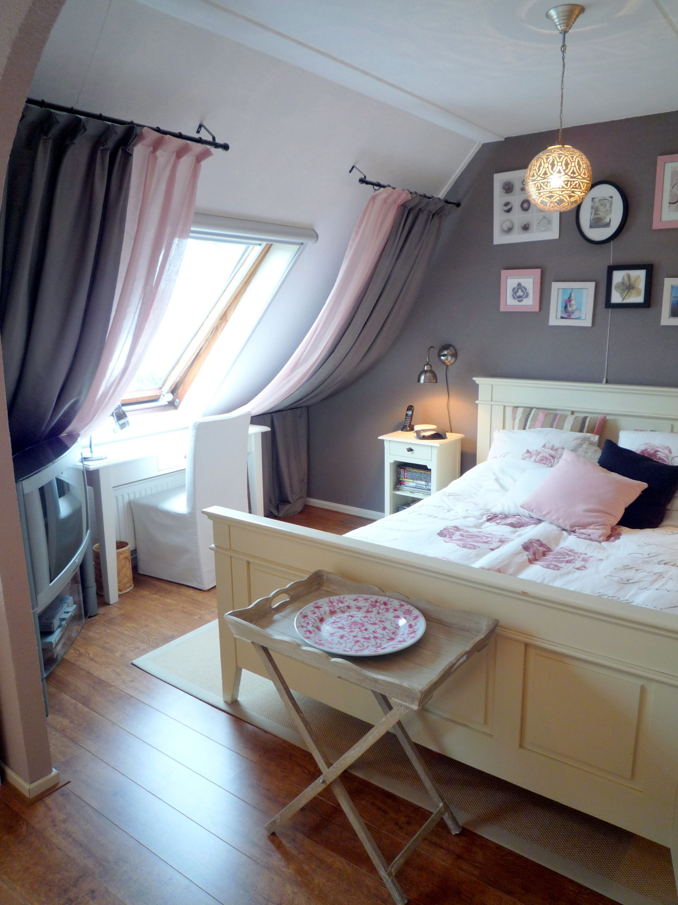 Bed against window with curtains  great way to add softness into a roof space bedroom  interior