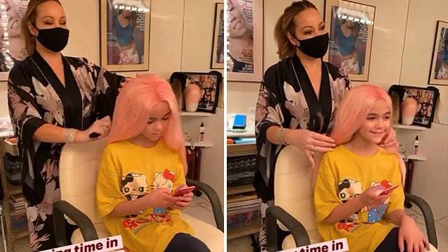 Mariah Carey brushes daughter's wig while wearing a face mask