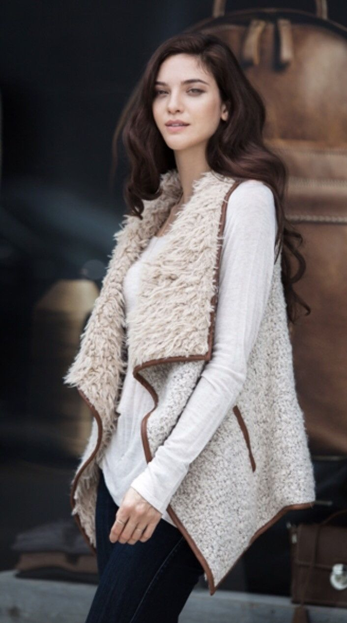 Keep your self warm, cozy and stylish by dressing up top with this cute sherpa vest accented with faux leather trim and oversize shawl collar.