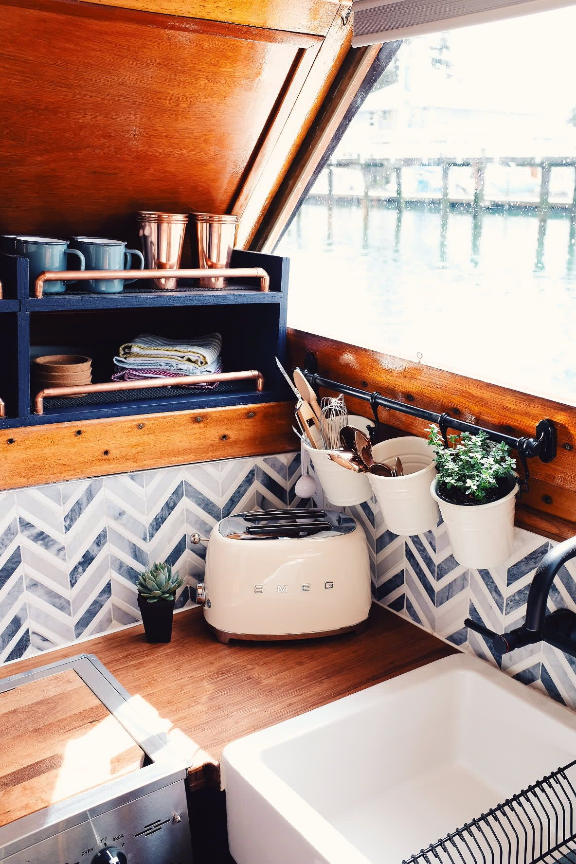 This Houseboat Has One of the Cutest Tiny House Kitchens #tinyhousestorage