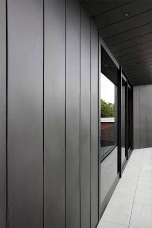 James hardie axon cladding charcoal grey black windows More