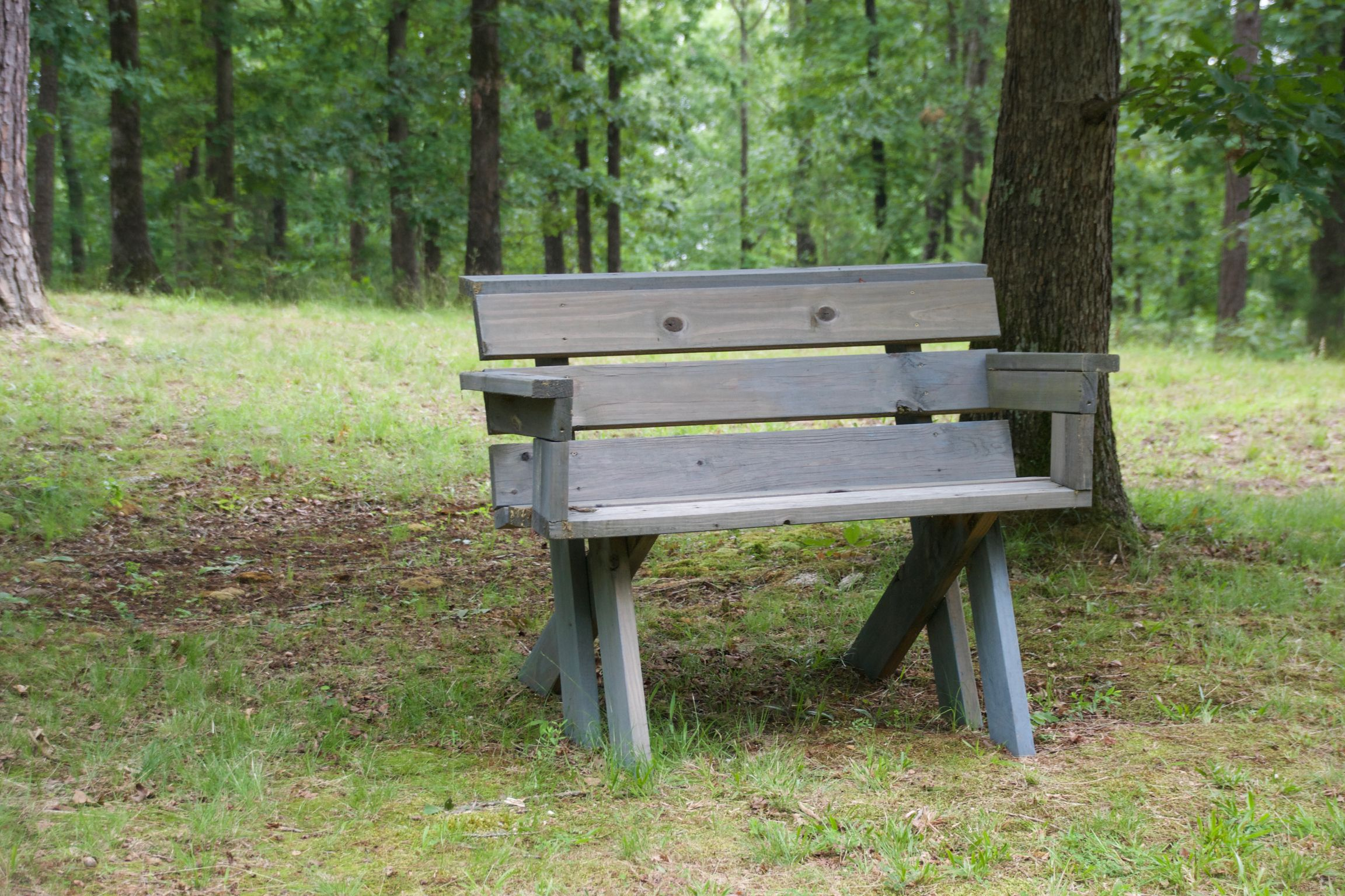 Outdoor wood bench with grey stain.