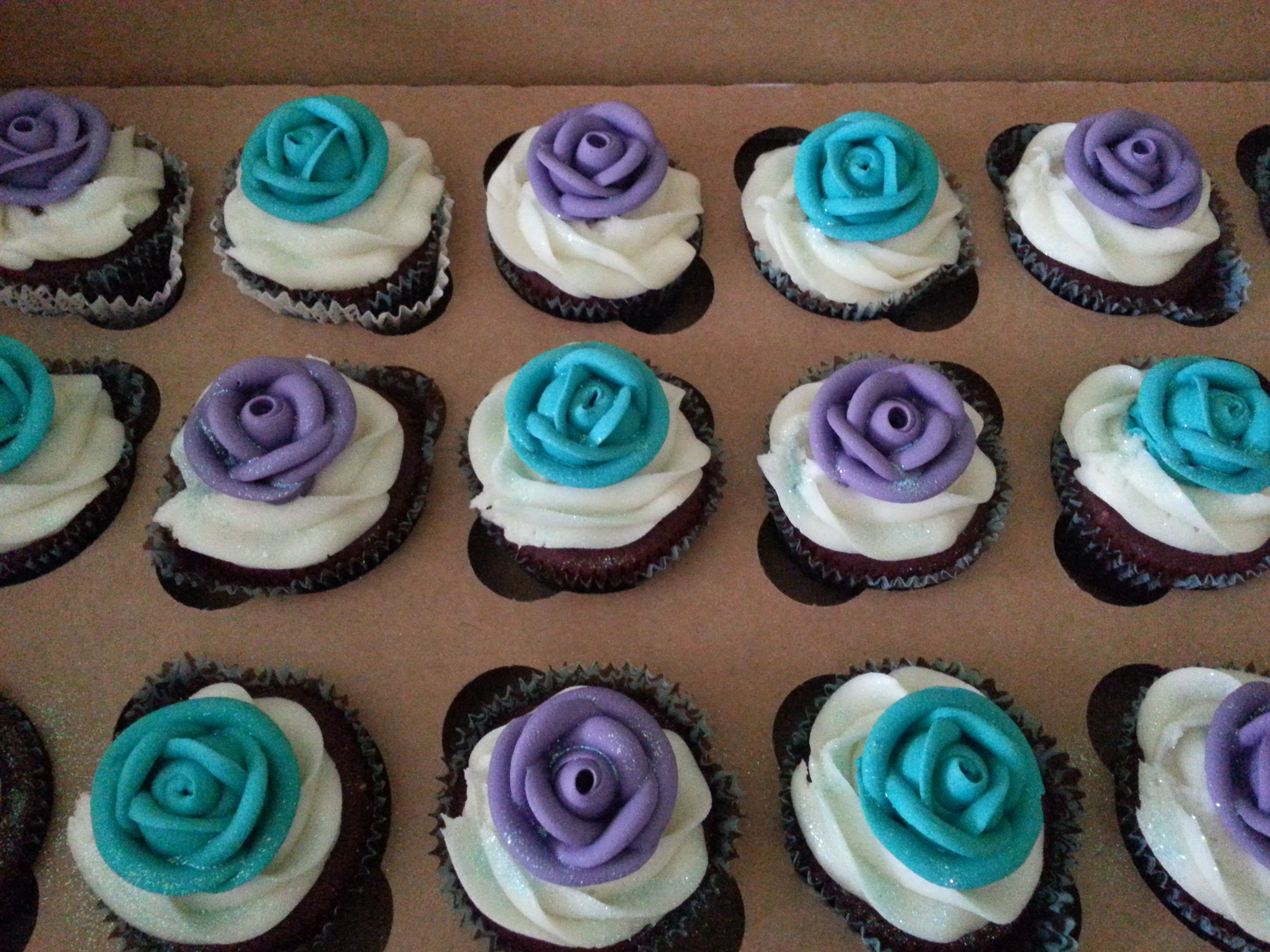teal and purple themed cupcakes for my daughter's communion