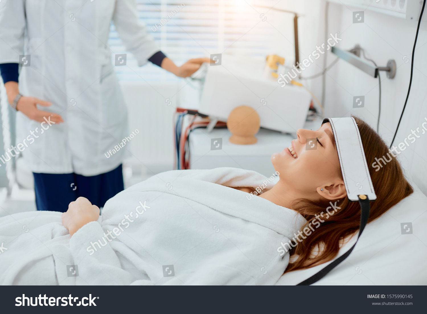 beautiful caucasian woman lying on bed in hospital, smile