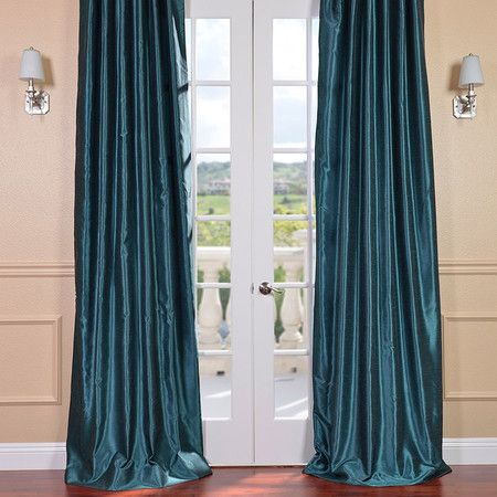 Featuring a lustrous peacock-hued fabric and flannel lining, this silk-inspired curtain adds a luxe touch to your master suite or guest room.  ...