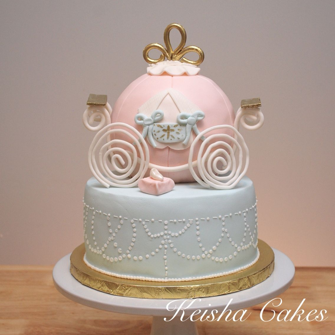 Cinderella pumpkin carriage cake. Pastels used were a pinky/peach ...