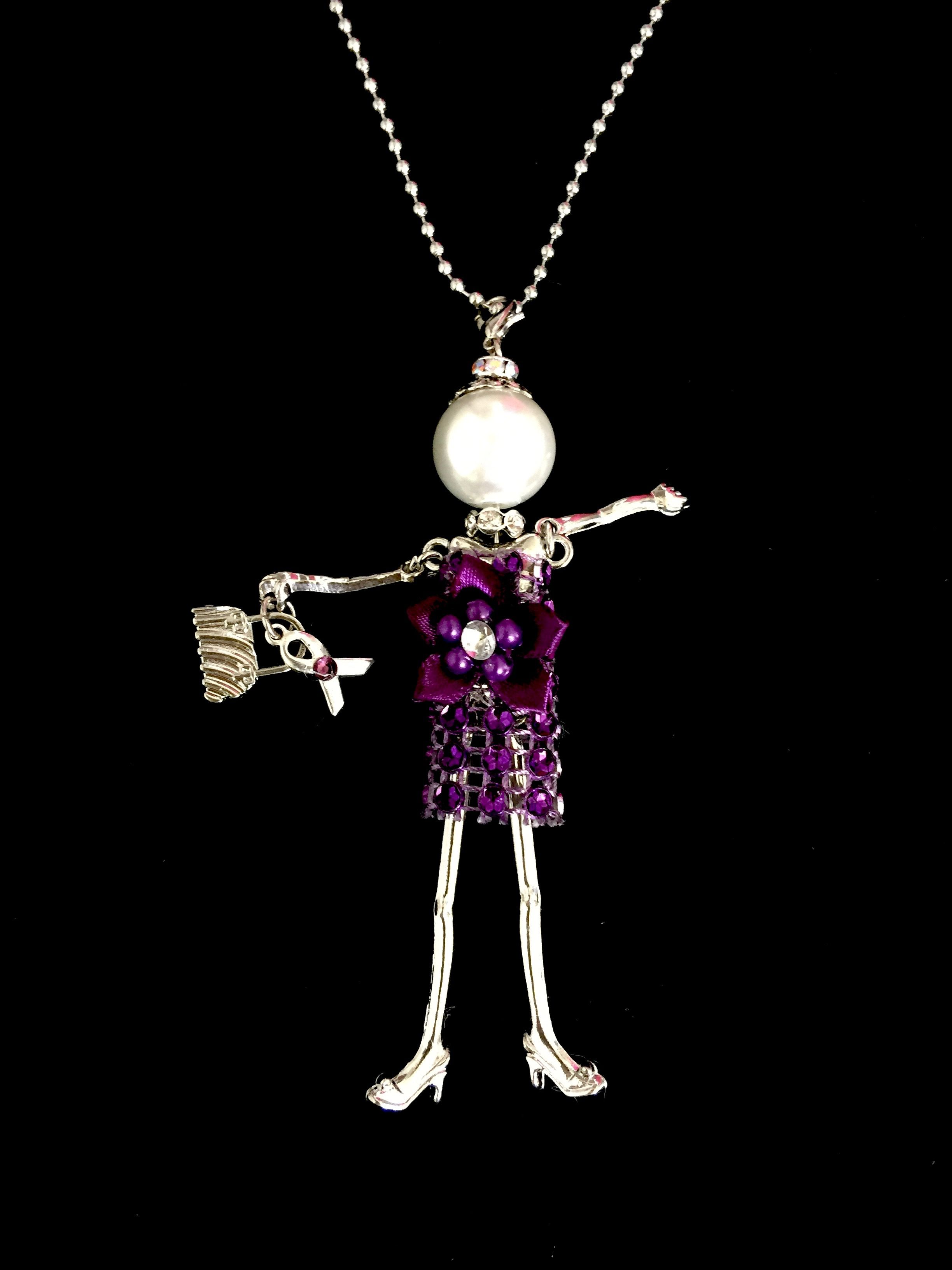 French doll necklace for pancreatic cancer support.