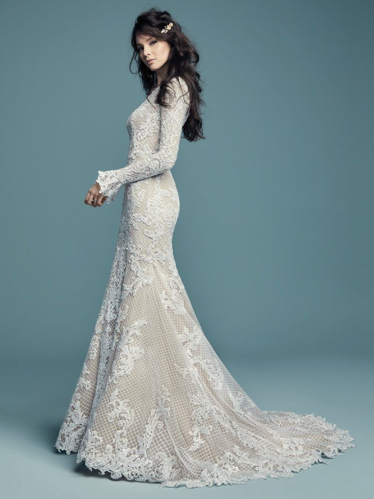 99ecff066b654 HAILEY LYNETTE Lace motifs cascade over netting and tulle in this unique fit-and-flare  modest wedding gown. Featuring a crew neckline, subtle V-back and ...