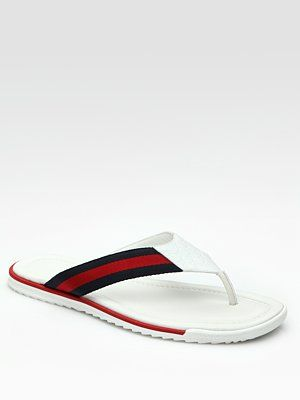 379cea71ec338 Gucci - Leather thong sandal with signature blue red blue web detail and  micro guccissima trim. Rubber sole Made in Italy
