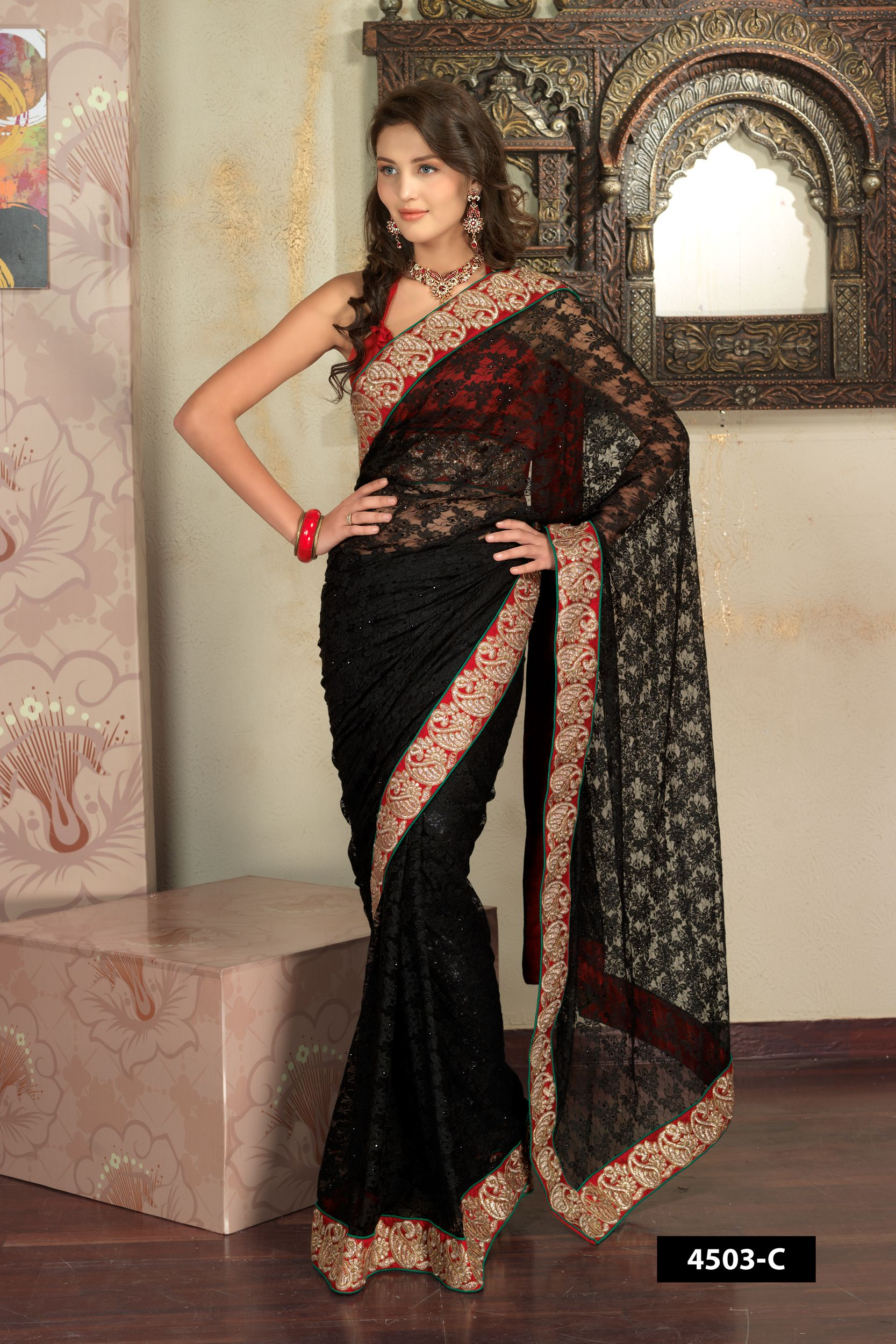 5ee1f6c3a1 Full net black designer saree with golden heavy embroidery border comes  with pink blouse