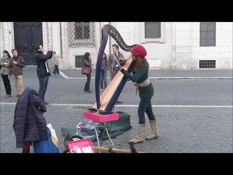Street Artist Plays Pachelbel Canon In D Major On Harp The And Moves Her Body According With Music Amazing