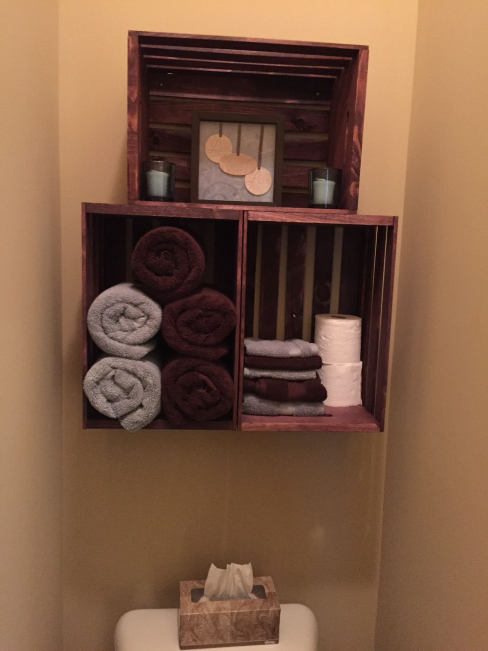 Crate stacked shelves above toliet