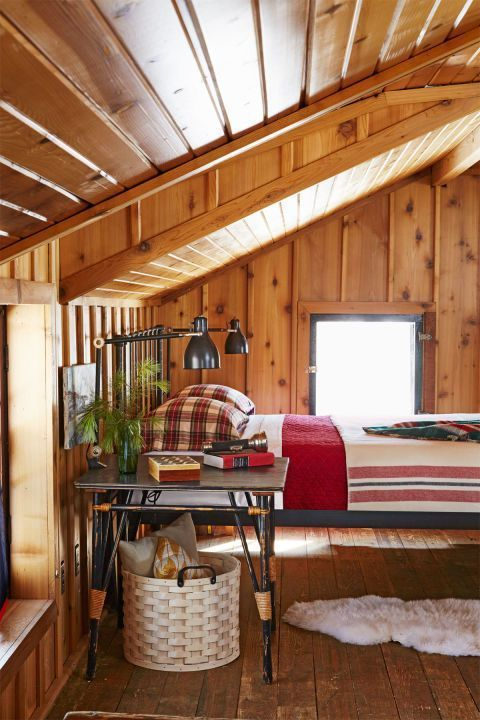 Minimal And Classic Cozy Cabin Bedroom With Stripes Plaid And A Sheepskin Rug Cozy Cabin Decor Cabin Interiors Cabin Style