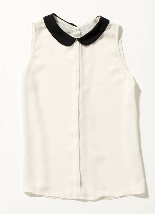 White blouse with black collar
