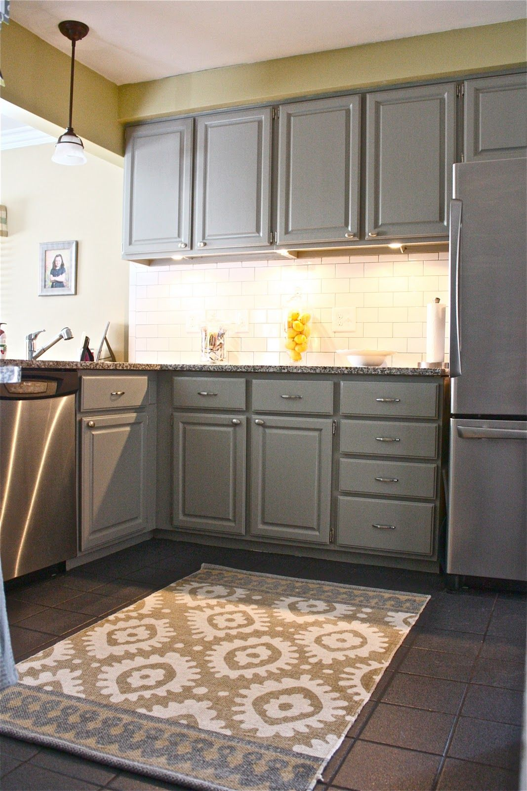 Mid gray cabinets with light yellow walls and accents for Grey yellow kitchen ideas