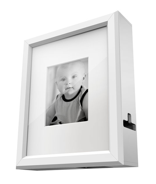 It\'s a photo frame that hides all of your diaper changing supplies ...