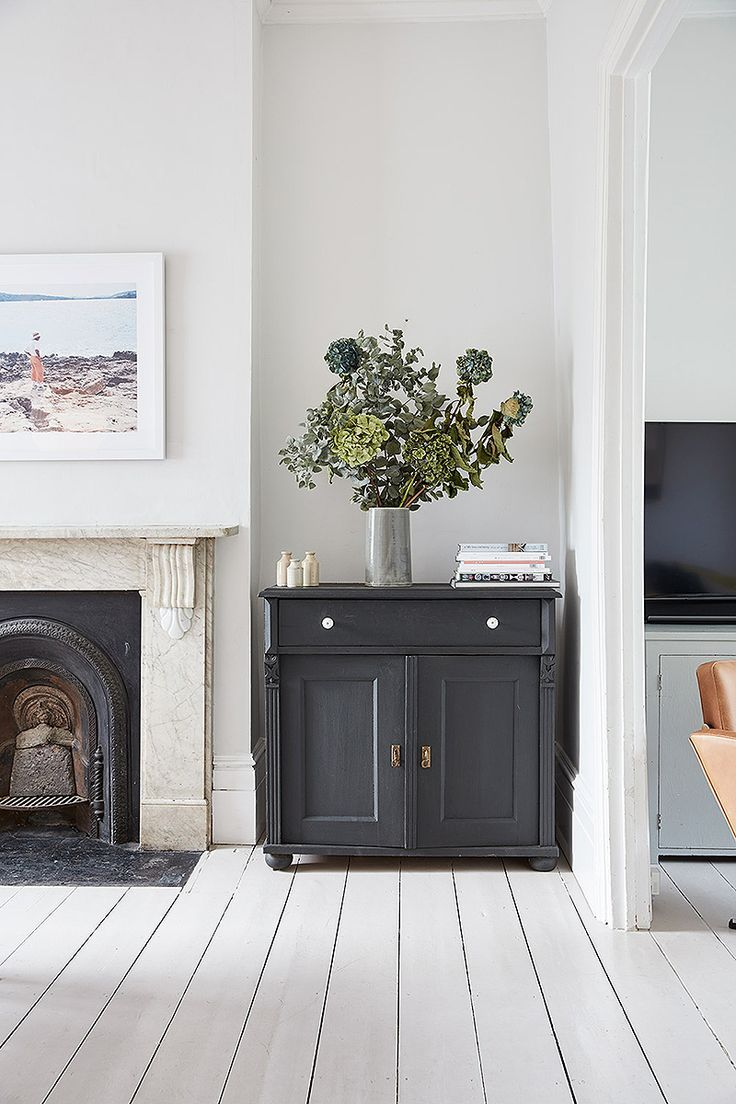 Dark grey cabinet in a white room - how to create a focal point ...