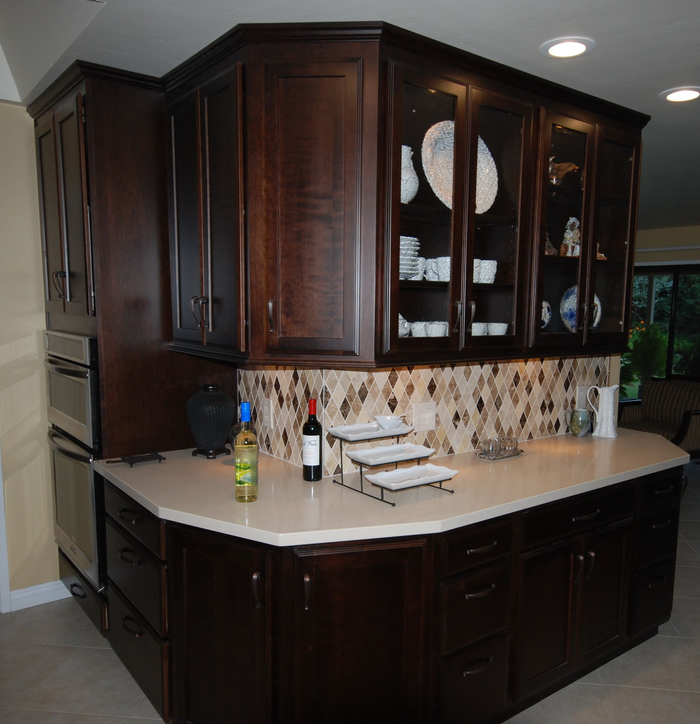 Starmark Cherry Cabinets With Mocha Stain With Caesarstone Dreamy Marfil Quartz And Marble Mosaic Kitchen Cabinets In Bathroom Cherry Cabinets Kitchen Remodel