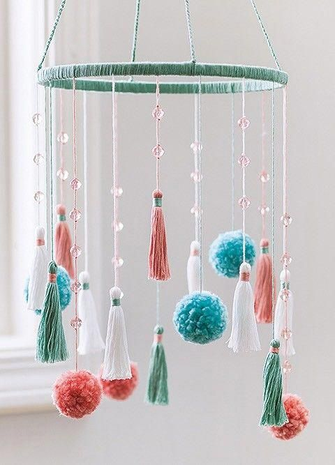 Top-Notch Tassels and Pom-Poms from Leisure Arts presents a fun collection of craft projects embellished with today's most popular trims. Spruce up the office with these grand chandeliers of fluffy pom-poms and tassels. #funcrafts