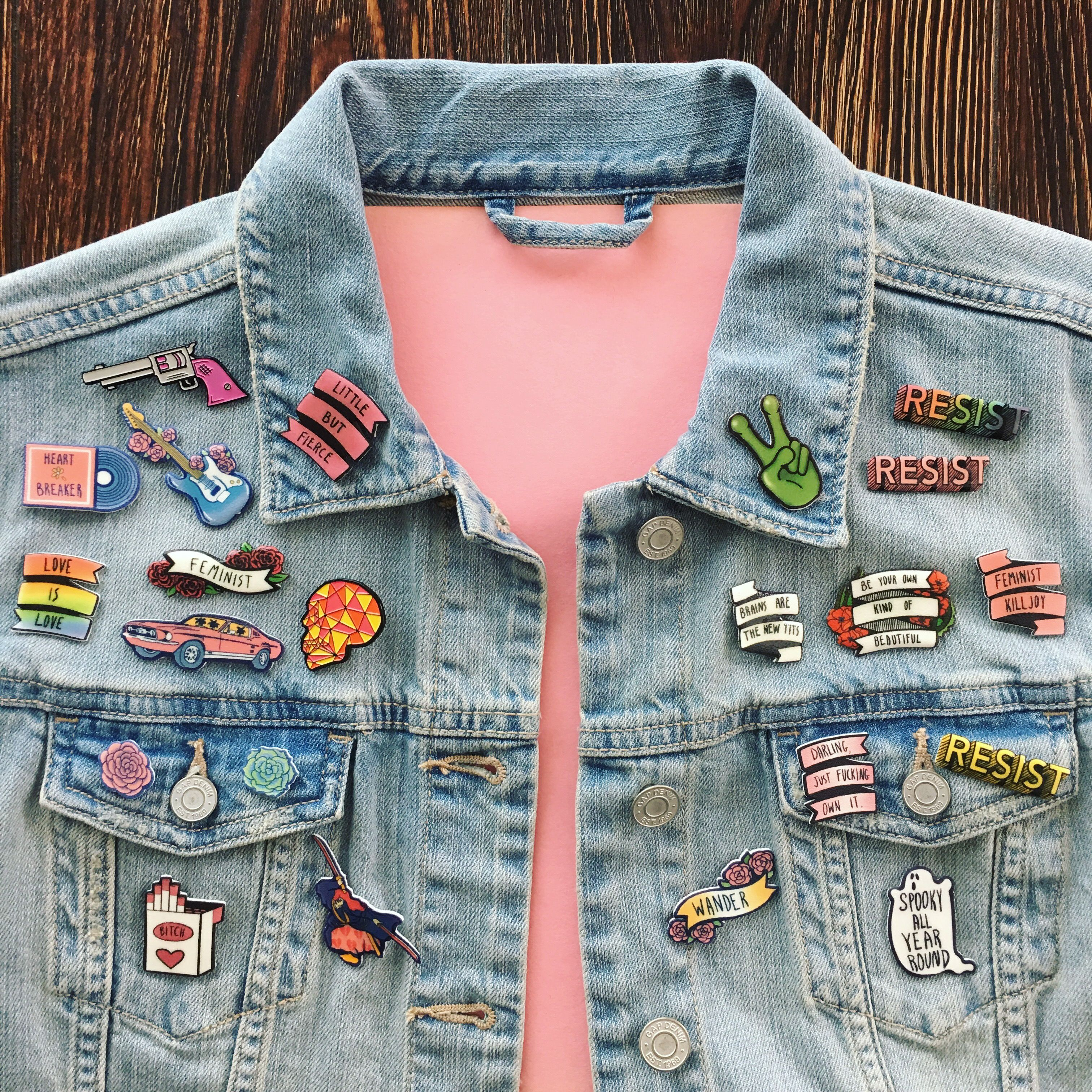 A cute denim jacket with a colorful pin collection with feminist ...