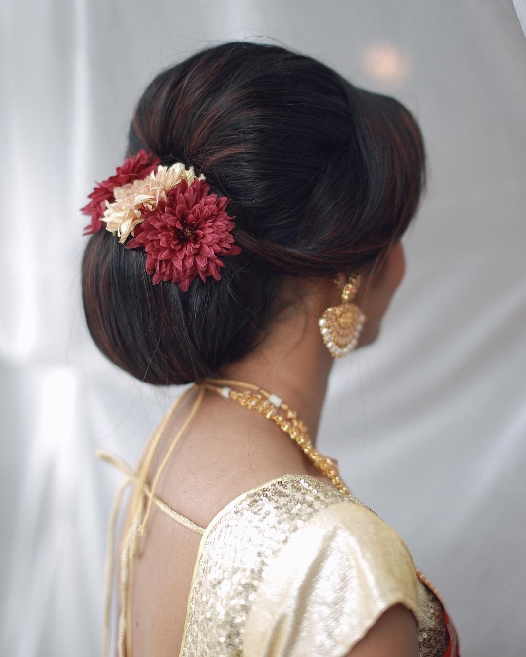 What A Beautiful Large Low Bun With Real Flower Gajra Care However Should Be Taken Before Adopting Such Low Bun Wedding Hair Bun Hairstyles Low Bun Hairstyles