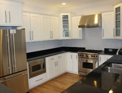 Antique White Shaker Kitchen Cabinets with Black Glass Countertops - Antique White Shaker Kitchen Cabinets With Black Glass Countertops