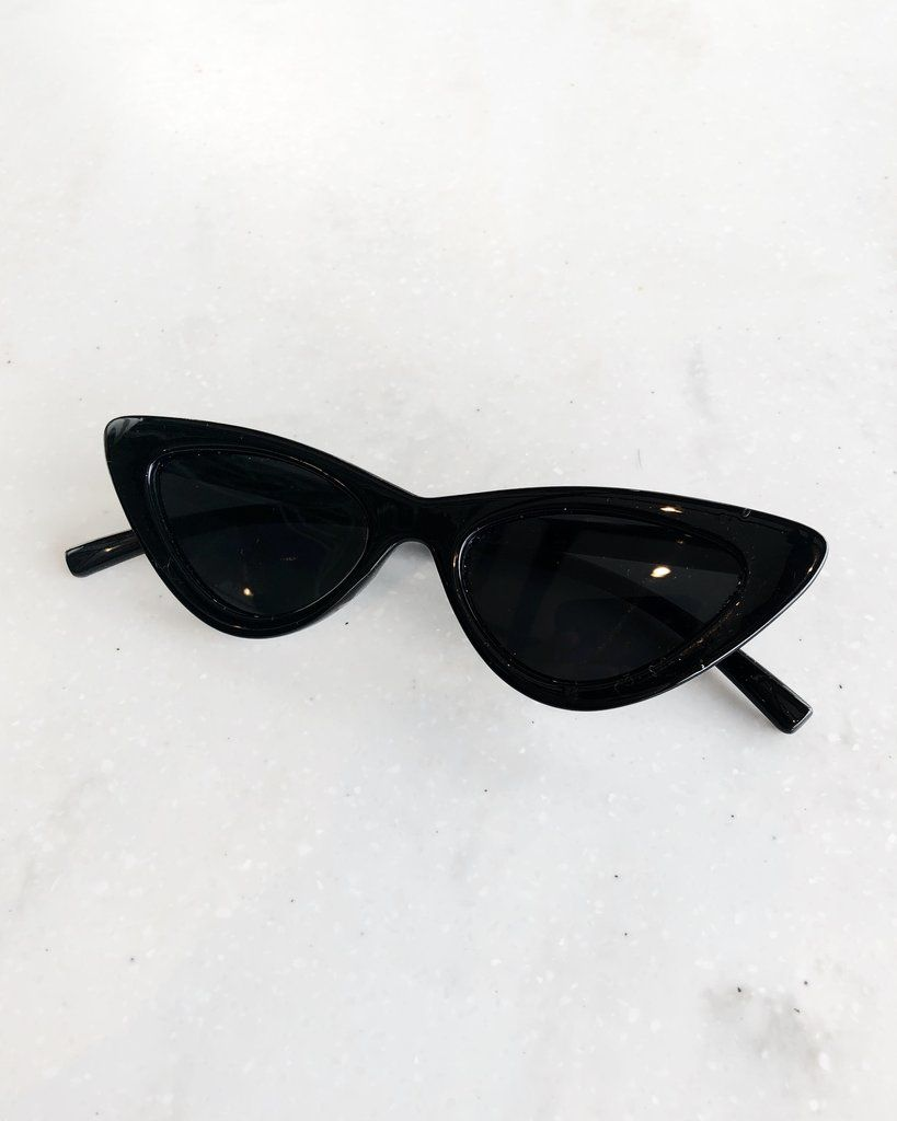 8b2f9a94d78 These slim retro cat eye sunglasses in black are a must-have old school  Lolita silhouette with jet black lenses that block 100% of UVA and UVB rays.