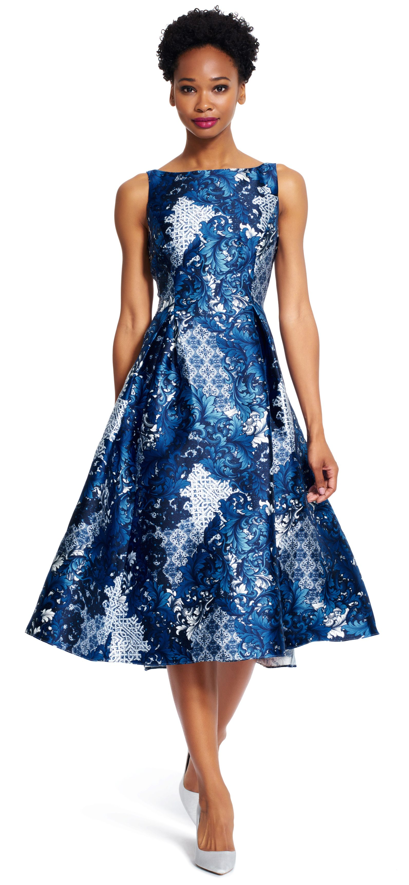 Featuring a stunning print throughout, this beautiful party dress is ...