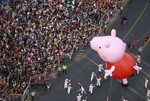 Santiago, Chile<br>The Peppa Pig balloon makes its way along the city streets during an annual Christmas parade