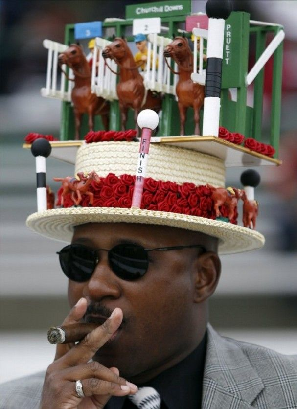 Eric Williams, from Chicago, smokes a cigar before the 137th Kentucky Derby horse race at Churchill Downs Saturday, May 7, 2011, in Louisville, Ky. (AP Photo/Matt Slocum)