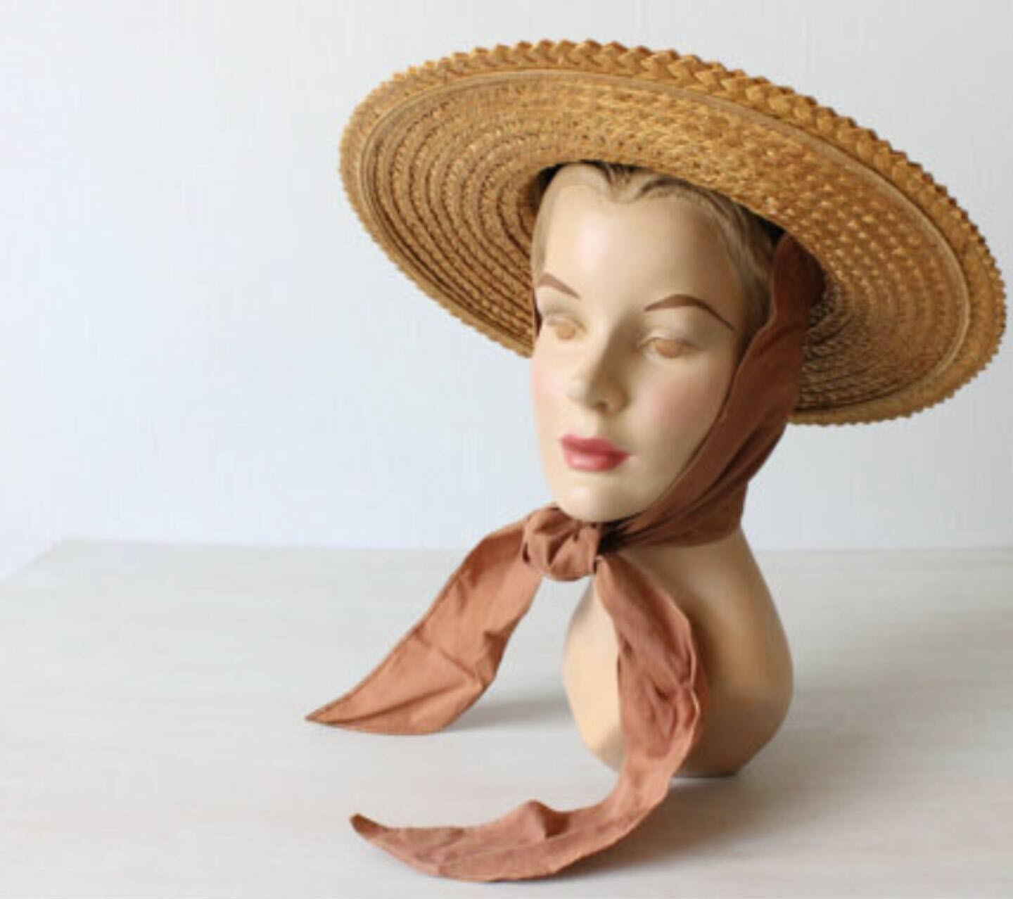 Wide brimmed straw hats that tie under the chin c969fe9c661
