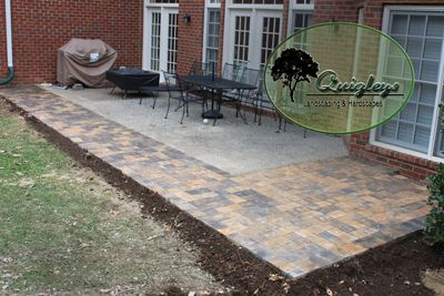 This image is of a patio extension using pavers Many people want