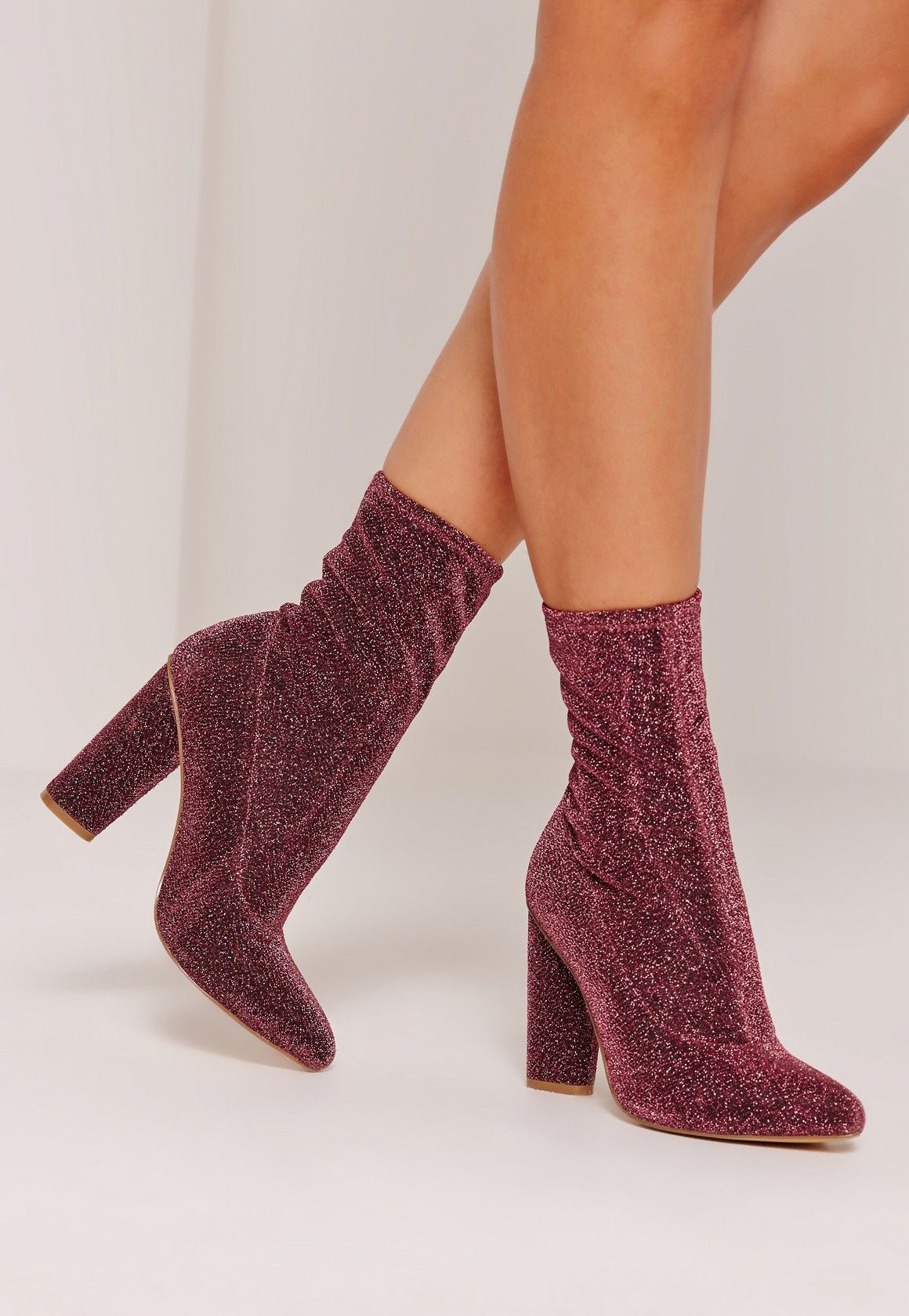 Throw it back to the 90s in these glitter sock boots in a rose pink hue