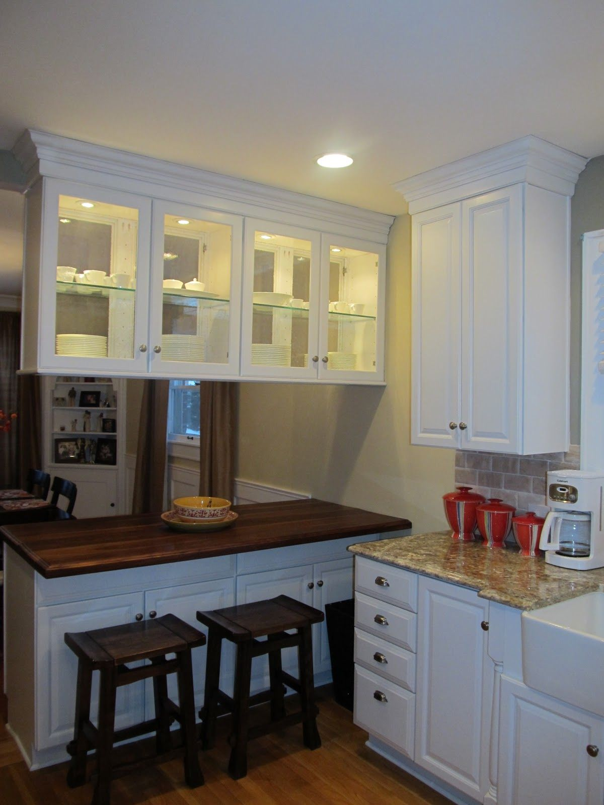Kitchen Peninsula But With Enclosed Cabinets Over And Chalkboard With Menu Or Large Image On Back Kitchen Design Hanging Kitchen Cabinets Kitchen Layout
