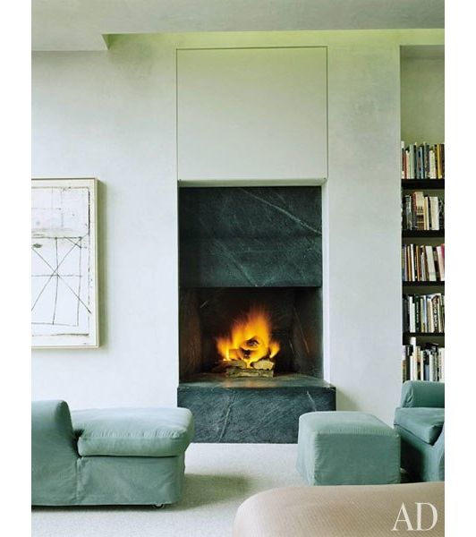 A raised fireplace by its inviting ambiance stylish comfy seating