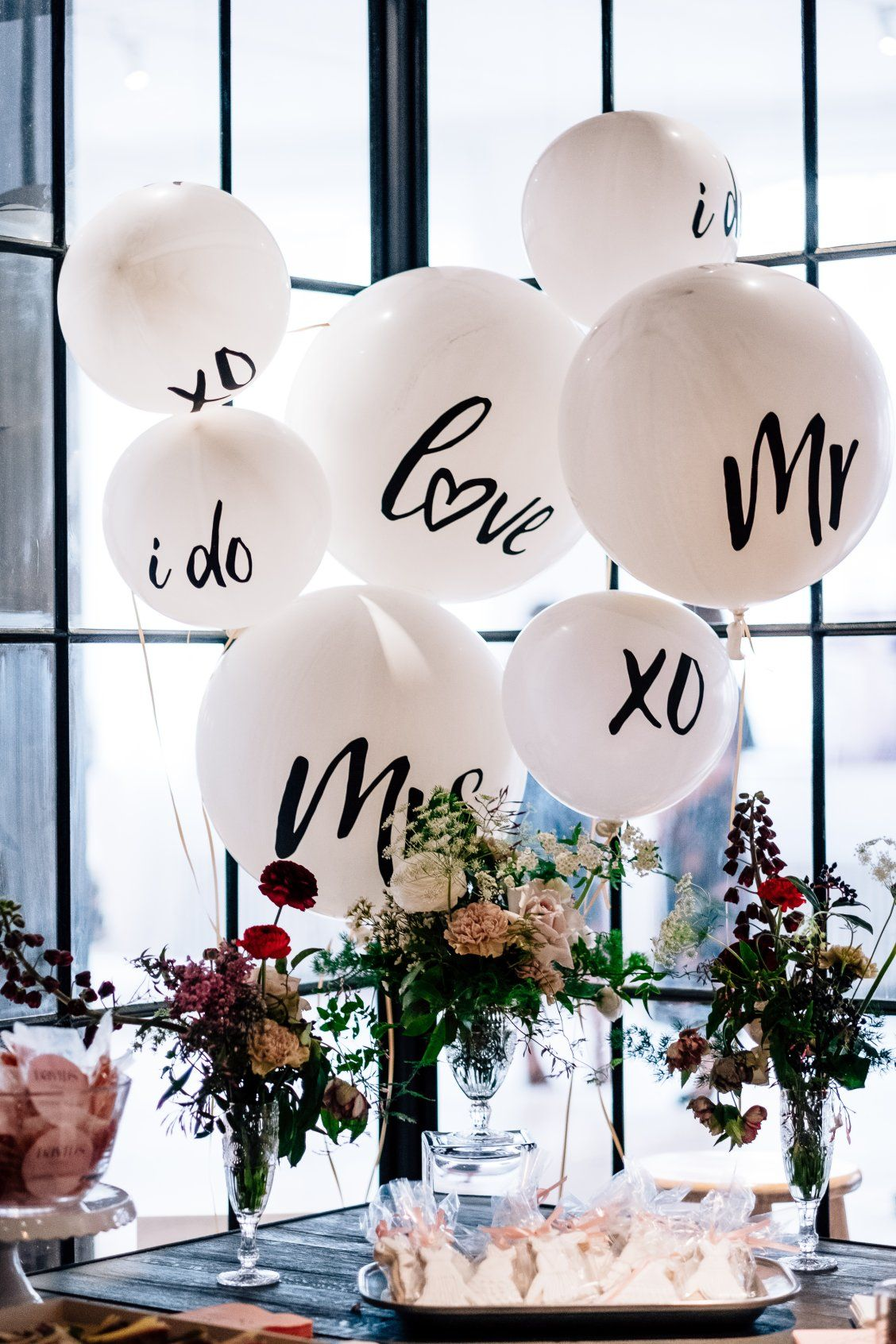 Move over flowers! We are loving wedding balloon decor! Shop these oversized love balloons, mr and mrs balloons, I Do balloons and XO balloons at davidsbridal.com #engagementparty